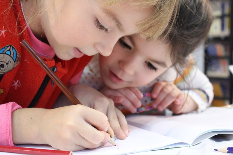 Primary school children writing